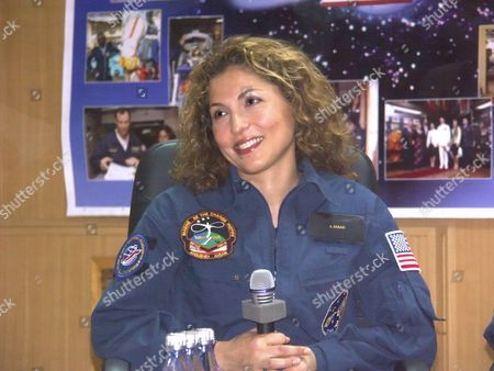 Baikonur, Kazakhstan, September 17, 2006, american space tourist anousheh ansari smiles for a photo, the 14th ISS crew is to launch from the Baikonur cosmodrome on September 18, the tma 9 spacecraft is on the launch pad at the Baikonur cosmodrome.