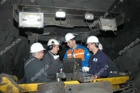 Norilsk, Russia, march 21, 2007, norilsk nickel ceo Mikhail prokhorov, second from right, and companyi´s future ceo denis morozov, right, talk to miners while touring the oktyabrsky mine of the norilsk nickel.