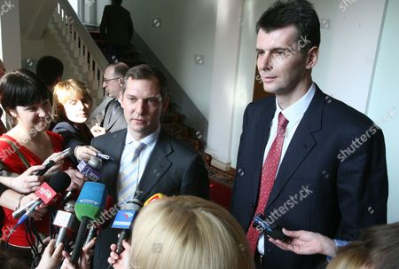 Krasnoyarsk, Russia, new norilsk nickel ceo denis morozov and former norilsk nickel ceo Mikhail prokhorov, l-r, answer questions from reporters after a meeting with the governor of Krasnoyarsk territory.
