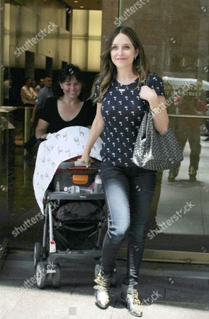 Stock Image of Jenny Mollen with son Sid Biggs
