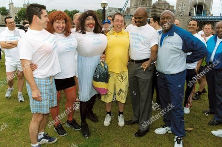 KRISS AKABUSI AND JOHN REGIS WITH RUNNERS
