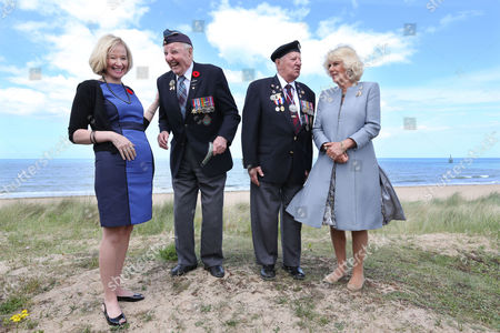 Camilla Duchess of Cornwall and Laureen Harper the wife of the Canadian Prime Minister meet veterans Lloyd Bentley (93) and Stanley Clarkefields (95)