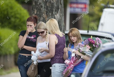 Some Young Girls Arrive At The Scene At Chells Grove Billesley West Midlands Where A Young Mother Yvonne Walsh And Her 9 Month Old Son Harry Were Found Murdered. (3/06/13).