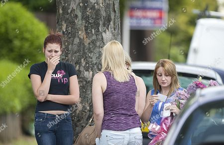 Some Young Girls Arriving Scene At Chells Grove Billesley West Midlands Where A Young Mother Yvonne Walsh And Her 9 Month Old Son Harry Were Found Murdered. (3/06/13).