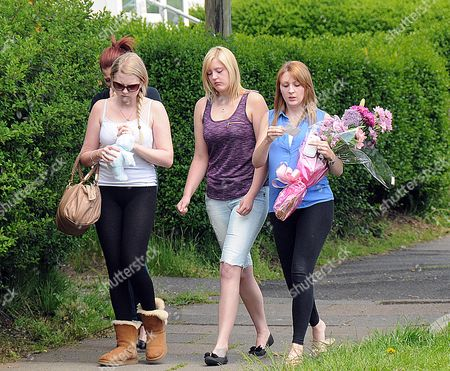 Young Girls Arrive At The Scene At Chells Grove Billesley West Midlands Where A Young Mother Yvonne Walsh And Her 9 Month Old Son Harry Were Found Murdered. (3/06/13).
