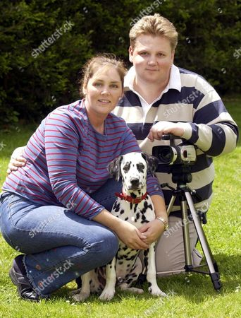Stock Image of DAVID AND NIKKI NUTLEY WITH DOG LUCAS