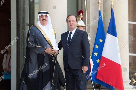 French President Francois Hollande (R) welcomes Saudi Prince Mutaib bin Abdullah Al Saud