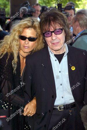 BILL WYMAN AND WIFE