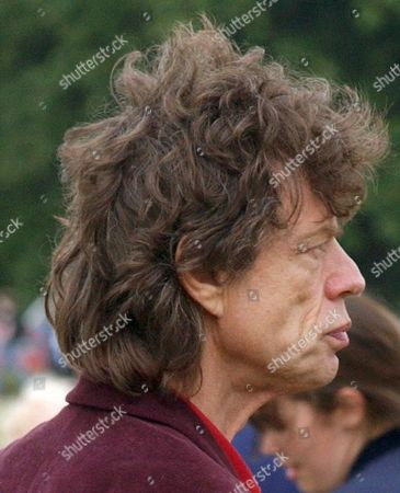 Stock Image of MICK JAGGER WITH GABRIEL LUKE BEAUREGARD JAGGER