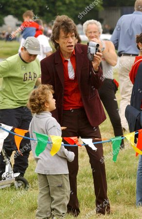 MICK JAGGER WITH GABRIEL LUKE BEAUREGARD JAGGER