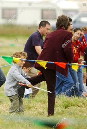 MICK JAGGER HAVING A SWORD FIGHT WITH SON GABRIEL LUKE BEAUREGARD JAGGER