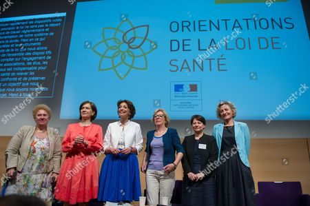 French Social Affairs and Health Minister Marisol Touraine (3rdL), flanked by Junior Minister for Higher Education and Research Genevieve Fioraso (3rdR) pose with Marie-Sophie Desaulle, general director of the Health regional Agency (Agence regionale de sante), French junior minister for Family, Elderly and Autonomy, Laurence Rossignol (2ndL), Professor Genevieve Chene (2ndR), head of the Public Health Center (Pole Sante Publique) and Bernadette de Victor (R), President of the Health national conference