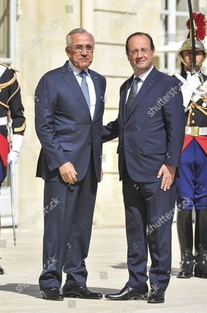 French President Francois Hollande and the Lebanese President Michel Suleiman leaving after the meeting