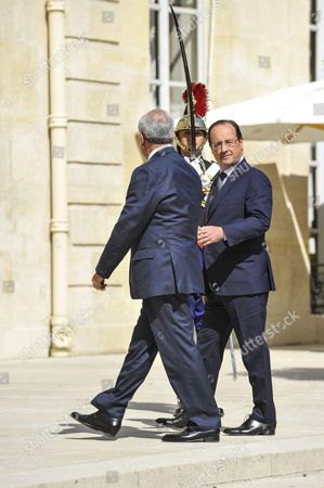 French President Francois Hollande and the Lebanese President Michel Suleiman going for a meeting