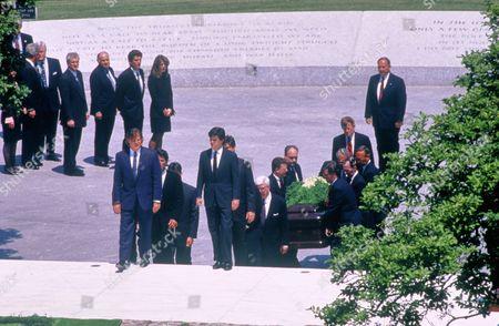 Stock Image of John F. Kennedy Jr and Caroline Kennedy Schlossberg attend the burial of Jacqueline Kennedy, Arlington, Virginia, America