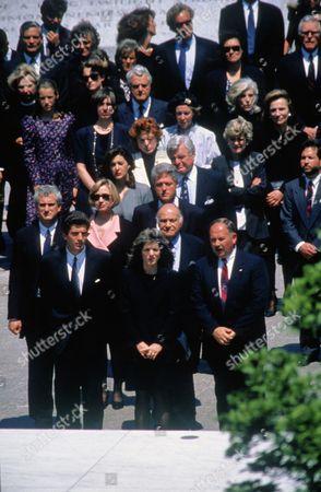 Stock Photo of John F. Kennedy Jr, Caroline Kennedy Schlossberg, President Bill Clinton and First Lady Hillary Clinton and Senator Robert Kennedy attend the burial of Jacqueline Kennedy, Arlington, Virginia, America