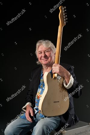 Stock Picture of London United Kingdom - September 11: English Guitarist And Songwriter Mick Ralphs Founding Member Of The Bands Mott The Hoople And Bad Company Photographed During A Portrait Shoot For Guitarist Magazine September 11
