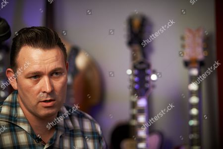 Reading United Kingdom - August 6: Portrait Of English Rock Musician Darrel Higham Guitarist With Irish Rock And Blues Performer Imelda May Photographed At His Home In Reading England On August 6