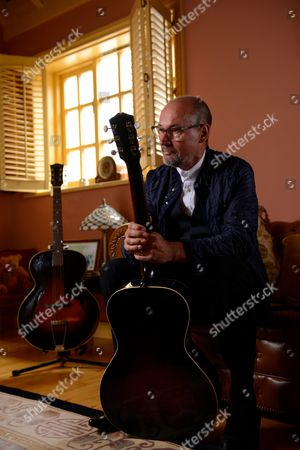 Cardiff United Kingdom - August 30: Portrait Of Welsh Rock Musician Andy Fairweather Low Photographed At His Home In Cardiff Wales On August 30 2013. Andy Fairweather Low Is Best Known As A Member Of 1960s Rock Group Amen Corner As Well As A Solo Artist And Touring Guitarist With Roger Waters And Eric Clapton
