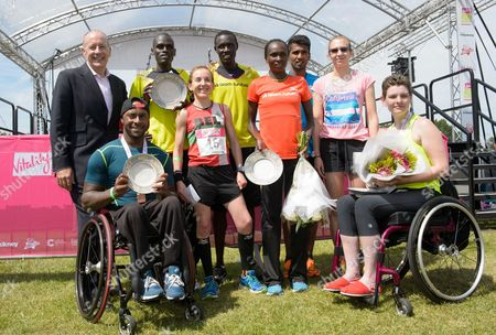 The Mayor of Hackney, Jules Pipe, with winners of the inaugural Vitality Run Hackney 2014, the winners and placed competitors are, from left to right, wheelchair Mens' race winner Ashley Archer, Mens' race winner Peter Emase, from Kenya, Bel Levene, third in the Women's race, Boniface Kongin, second in the Mens' race from Kenya, Gladys Yator, Womens' race winner, from Kenya,  Anuradha Cooray from Sri Lanka, third in the Mens' race, Katie Webster, second in the Womens' race and Women's Wheelchair race winner, Susan Cook.