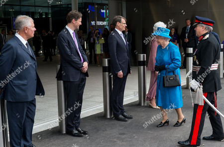 Queen Elizabeth II is greeted by Sir Nigel Rudd, Chairman of London Heathrow, John Holland-Kaye Heathrow Development Director and Colin Matthews, CEO of London Heathrow to open Terminal 2: The Queen's Terminal at Heathrow Airport