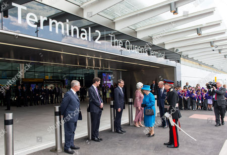 Queen Elizabeth II and Prince Philip are greeted by Sir Nigel Rudd, Chairman of London Heathrow, John Holland-Kaye Heathrow Development Director and Colin Matthews, CEO of London Heathrow to open Terminal 2: The Queen's Terminal at Heathrow Airport