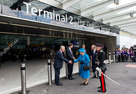 Stock Image of Queen Elizabeth II and Prince Philip are greeted by Sir Nigel Rudd, Chairman of London Heathrow, John Holland-Kaye Heathrow Development Director and Colin Matthews, CEO of London Heathrow to open Terminal 2: The Queen's Terminal at Heathrow Airport
