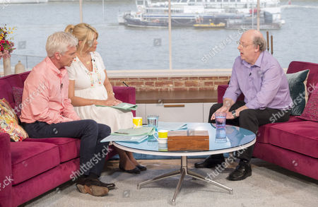 Presenters Phillip Schofield and Holly Willoughby with Peter Wilson