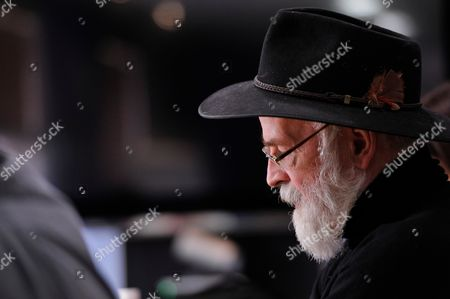 Portrait Of English Fantasy Author Sir Terry Pratchett During A Meeting With Sfx Magazine To Promote His New Book The Long Earth Co-written With English Science Fiction Writer Stephen Baxter On May 16