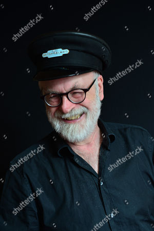Stock Photo of London United Kingdom - September 18: Portrait Of English Fantasy Author Sir Terry Pratchett Photographed To Promote The 40th Novel In His Discworld Series Raising Steam On September 18