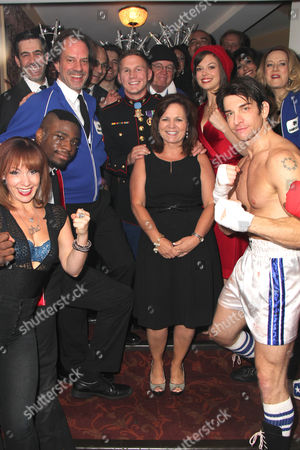 Cpl Kyle Carpenter, his mother Robin Carpenter, Margo Seibert, Andy Karl and the cast of Rocky The Musical