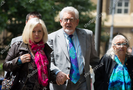 Rolf Harris with his daughter Bindi Nicholls (L) and wife Alwen Hughes ( R)
