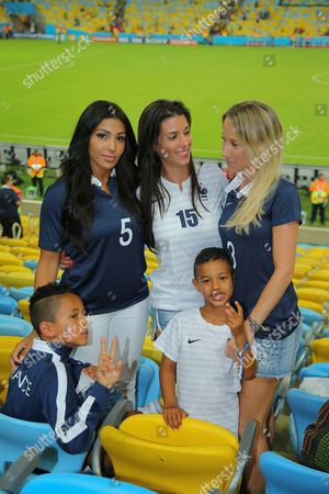 French wags Mazda Sakho (5) Ludivine Sagna (15) and Sandra Evra (5) and her two boys