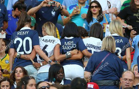 French wags Fanny Remy, Fiona Cabaye, Mazda Sakho, Ludivine Sagna and Sandra Evra