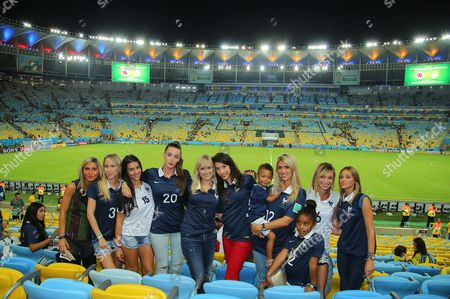 French wags (L-R) Sandra Evra (3) Ludivine Sagna (15) Fanny Remy (20) Jennifer Giroud (red Pant) Elodie Mavuba (12) with her 2 young children Tiago and Uma, Fiona Cabaye (6)