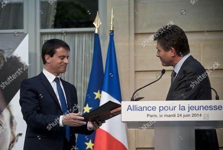 Manuel Valls and AXA CEO Henri de Castries