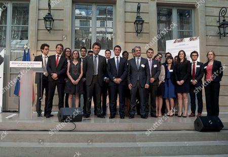 Nestle Europe CEO Laurent Freixe, Manuel Valls and AXA CEO Henri de Castries.