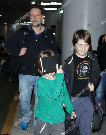 Editorial photo of Russell Crowe and family at LAX Airport, Los Angeles, America - 26 Jun 2014