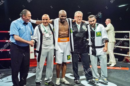 Jean-Marc Mormeck poses with his coach and team after his victory