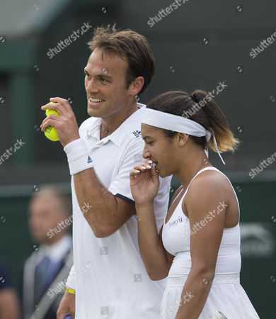 Heather Watson and Ross Hutchins of Great Britain in action in the first round of the mixed doubles