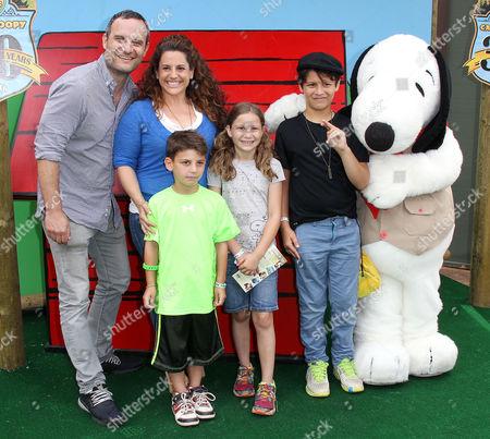 Stock Image of Marissa Jaret Winokur, Judah Miller and children with Snoopy
