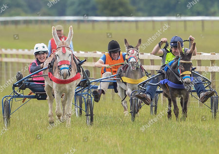 Stock Picture of Claire Lomas, Marcus Armytage and Charlie Brooks taking part in the celebrity donkey race at the Heythrop Hunt Country Fair