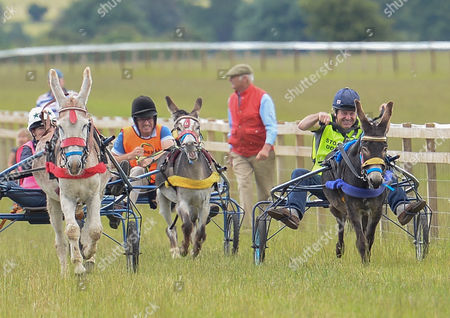 Claire Lomas, Marcus Armytage and Charlie Brooks taking part in the celebrity donkey race at the Heythrop Hunt Country Fair