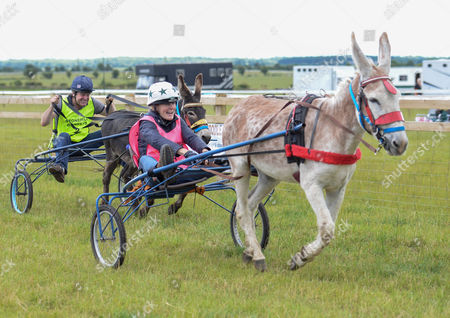 Stock Photo of Claire Lomas wins the celebrity donkey race ahead of Charlie Brooks in second place.