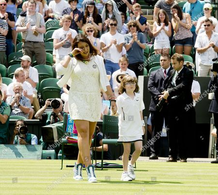 Coin toss ceremony on centre court in honour of Elena Baltacha., Marion Bartoli with 9 year old Elle Robus-Miller from the Elena Baltacha academy of Tennis