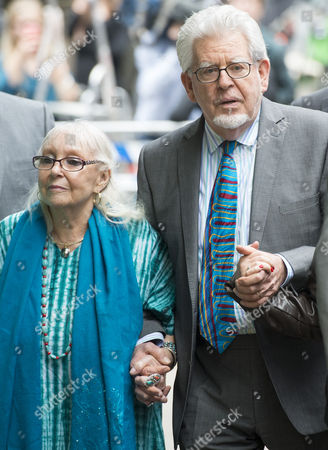 Rolf Harris and wife Alwen Hughes leaving court after being found guilty