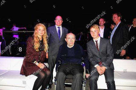 Sir Frank Williams, owner of the Williams Grand Prix team attends with his supporters after helping the new formula establish technology with his company