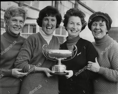 Stock Image of Elizabeth Russell-cave Cynthia Barrett Ruth Ferguson And Gill Cheetham Holding The Winners Cup For The Daily Mail Women's Foursome Golf Tournament At Hillside Southport.