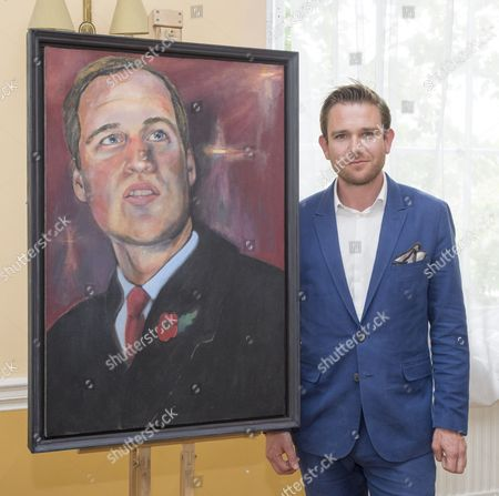 Dan Llywelyn Hall with his portrait of Prince William