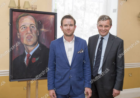 Dan Llywelyn Hall with his portrait of Prince William, accompanied by the Secretary of State for Wales David Jones